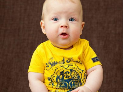 Adorable Baby in Yellow with Camera