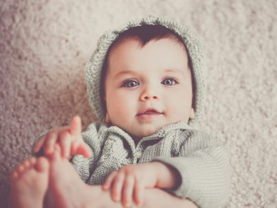 Adorable Baby in Sweater