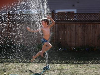 Boy Jumping in water
