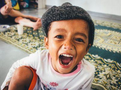 Boy showing teeth